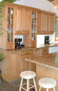 Cabinets, glass doors and coffee makers